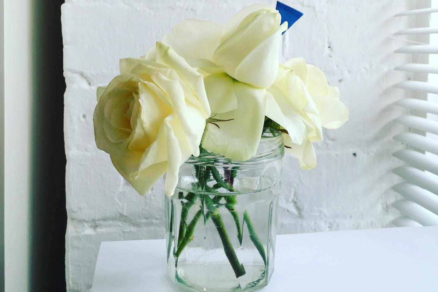 White roses in a jam jar